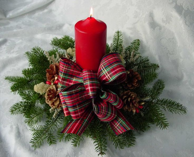 a cozy Christmas wedding centerpiece of fir, plaid bows and a red candle is easy to make and looks holiday like