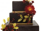 a chocolate square wedding cake decorated with fall blooms and leaves is a very stylish and bold idea