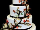 a white wedding cake decorated with a sugar branch and leaves and some blooms is a simple and cute idea