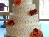 a patterned fall wedding cake decorated with bright fall blooms is a chic and bold idea