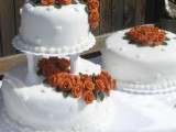 white patterned wedding cakes decorated with lush sugar blooms in rust for a fall feel