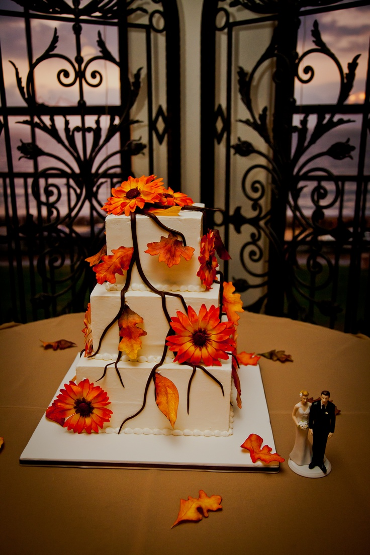 a fall wedding cake decorated with sugar branches and blooms is a stylish idea for the fall