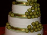 a large fall wedding cake decorated with small green apples feels and looks really fall-like