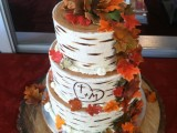 a birch bark wedding cake decorated with sugar fall leaves and pumpkins is ideal for a rustic wedding