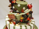 a whimsical green and white wedding cake with polka dots, stripes, fall leaves and pumpkins