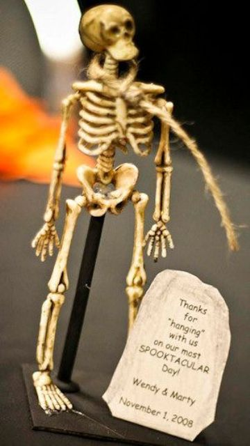 a mini skeleton with a tag is a creative and fun Halloween wedding favor that you can DIY