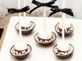 marshmallows with chocolate and nuts on sticks are creative and budget-friendly Halloween wedding favors