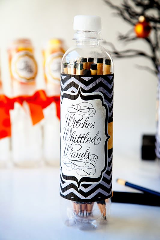 long and thin cookies in a bottle styled as witches' witted wands are unique and bold Halloween wedding favors