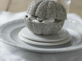 a silver glitter pumpkin with white candies is a lovely and cool Halloween wedding favor to rock