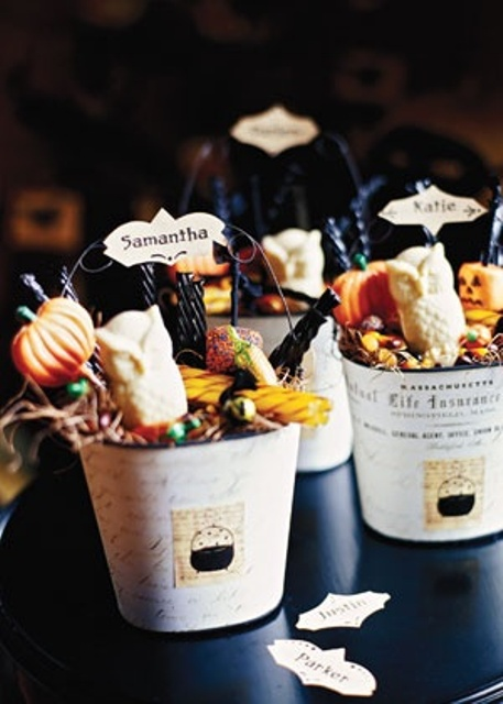 buckets with various kinds of candies and chocolate and tags are nice rustic Halloween wedding favors you can make yourself