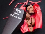 a coffin box with chocolate skulls is a cool Halloween wedding favor that you can pack for anyone