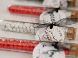 test tubes with white and red candies and tags with bows are nice and easy Halloween wedding favors