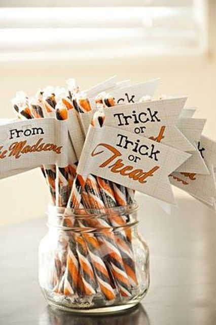 striped orange, black and white candies with tags are nice for Halloween weddings and won't break the bank