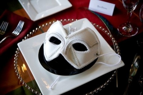 an elegant white embellished mask is a fantastic Halloween wedding favor for a masquerade wedding