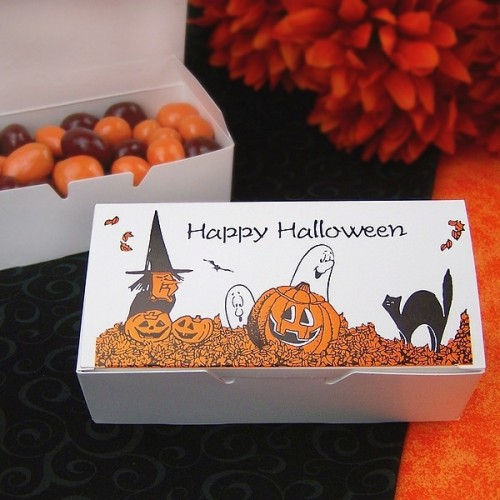 a Halloween box with brown and orange candies is a cool wedding favor idea to rock