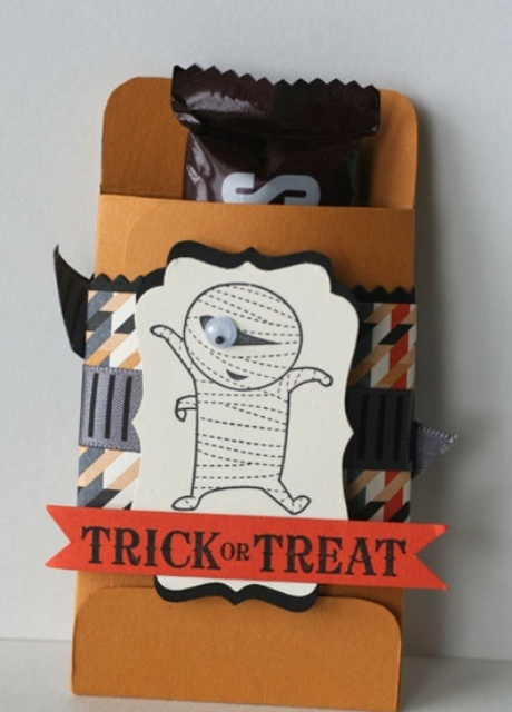 a Hershey's bar in a paper pack with creative tags and letters is a fun and whimsy Halloween wedding favor