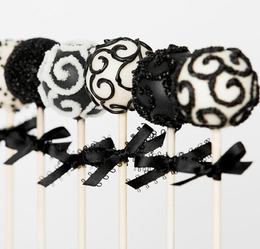 black and white patterned glitter cake pops with bows are elegant and glam Halloween wedding favors