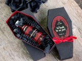 a black and red coffin box with a mini alcohol bottle is a crowd-pleasing wedding favor for adults