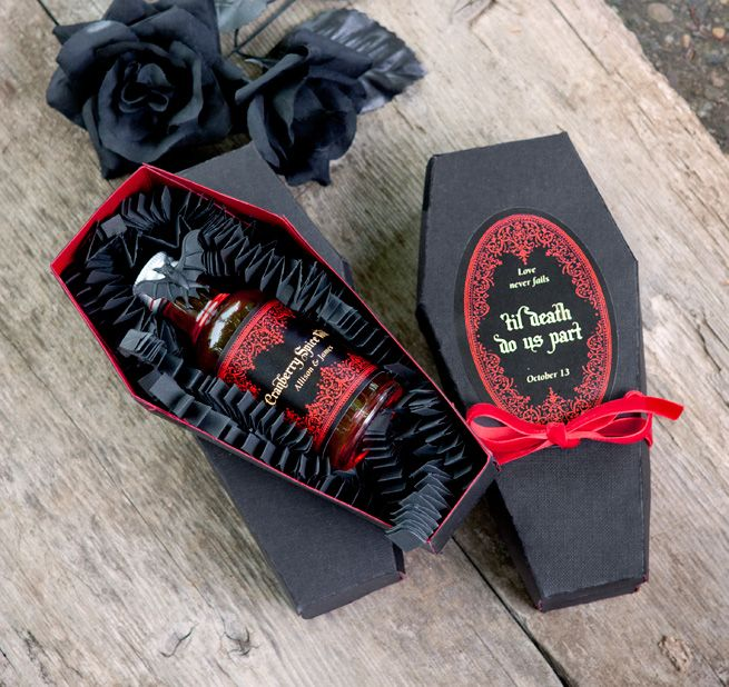 a black and red coffin box with a mini alcohol bottle is a crowd pleasing wedding favor for adults