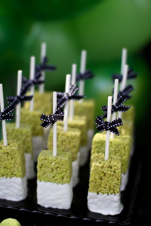 krispie rice pops with bows are cute and bold Halloween wedding favors you can make yourself