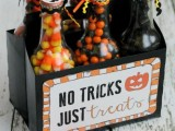 bottles filled with colorful and black candies are cool and easy Halloween wedding favors that will please everyone
