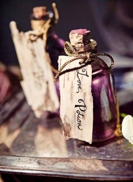 mini alcohol bottles styled as poison ones and with tags are cool wedding favors for adults for Halloween