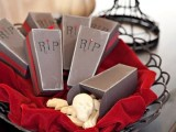 coffin boxes with white chocolate skulls are perfect Halloween wedding favors that show off the spirit of the holiday