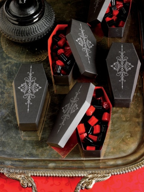 painted coffin boxes with black and red candies are cool themed Halloween wedding favors to rock