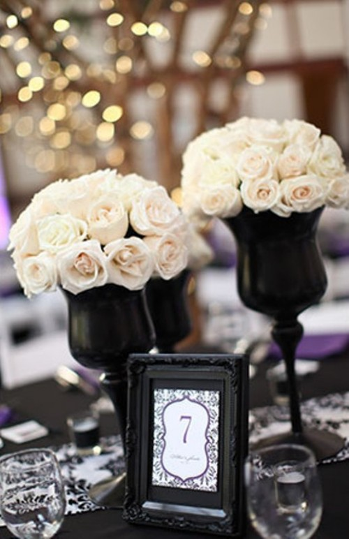 black vases with lush white roses for an elegant and formal centerpiece