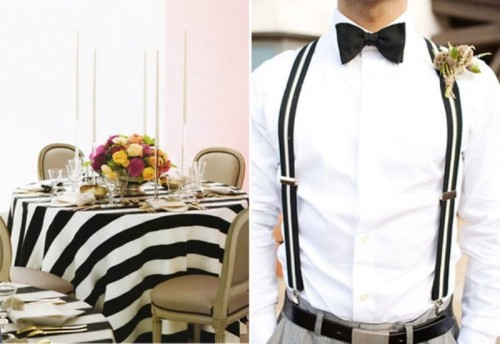 a white shirt, striped black and white suspenders and a black bow tie