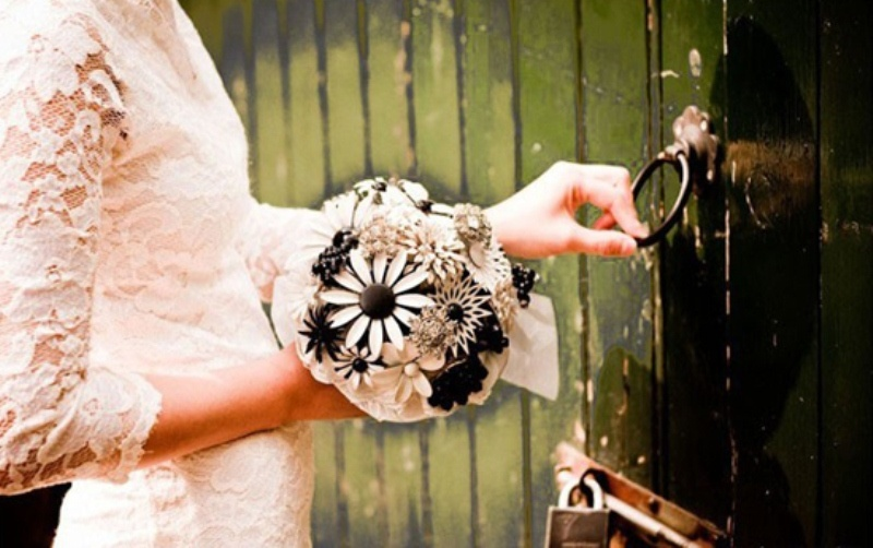 a wedding brooch wedding bouquet done in black and white