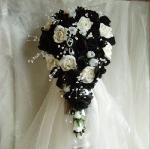 a black and white wedding bouquet of fake blooms is a durable idea