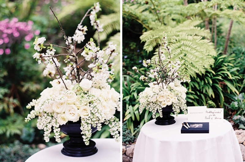 a black vase with lush white blooms will be a nice wedding centerpiece