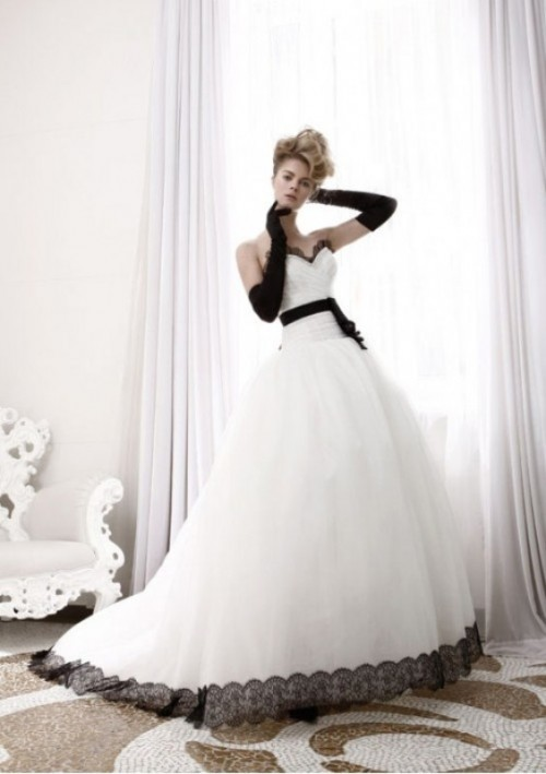 a princess-style wedding gown with black gloves and a black sash