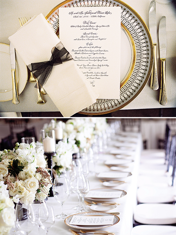 white candles in black candle holders, lush white blooms and black, white and gold chargers