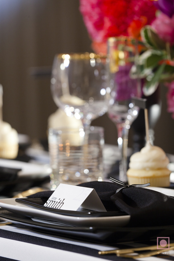 black and white plates, black napkins, gilded cutlery