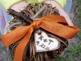 a vine pumpkin with rust ribbons and a burnt wooden heart tag to decorate your wedding venue
