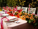 a super bright peachy bloom table runner is ideal for an outdoor fall wedding