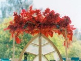 a unique fall wedding decoration with lush red leaves and blooms will make a statement and will help you embrace the season