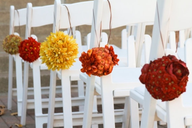 bright floral pomanders to decorate the aisle is a fun and bold idea for aisle decor