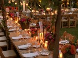 bright fall floral arrangements in buckets, greenery and floral installation with candles