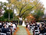 fall leaves to line up the outdoor wedding aisle is a cute option for an outdoor fall wedding