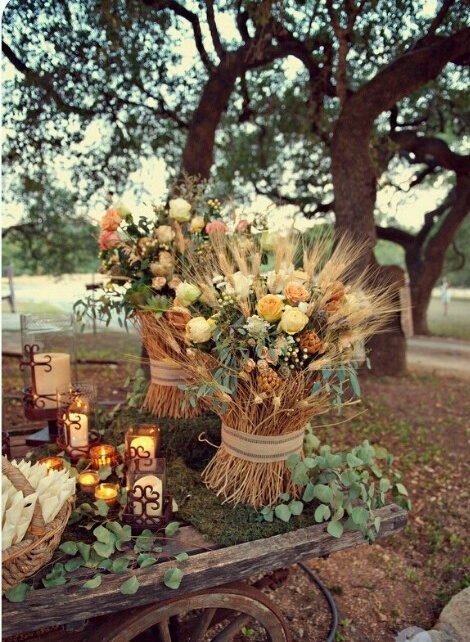 beautiful fall wedding decor with an arrangement of blooms, wheat and foliage plus moss