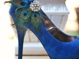 bright blue wedding shoes accented with peacock feathers and vintage brooches
