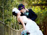 a bright purple, turquoise wedding bouquet with peacock feathers is a cool idea