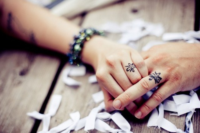 If there are any symbols or images for your couple, tattoo them on your fingers, so that only you two could know the meaning