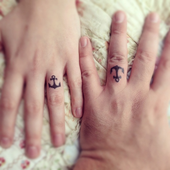 Matching anchors ring finger tattoos are nice for those who love the sea and are having a coastal wedding