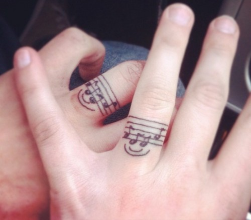 Marriage tattoo rings of music lovers