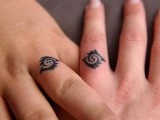 Tribal married couple matching tattoos look very original and unusual