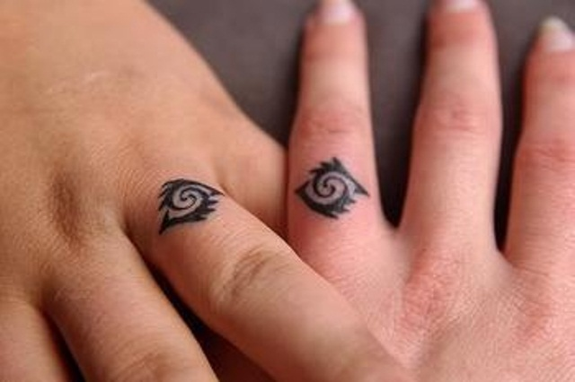 tribal married couple matching tattoos - Wedding Ring Finger Tattoos